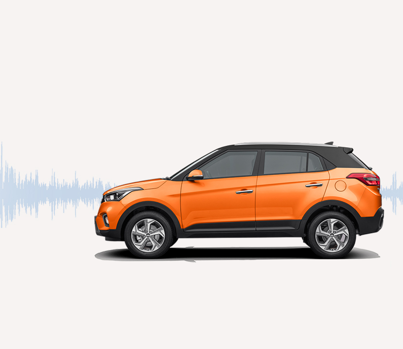 Side view of silver Creta with sound wave graphic on the background